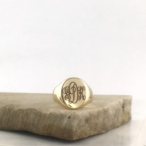 oval signet ring engraved with interlocking script initials