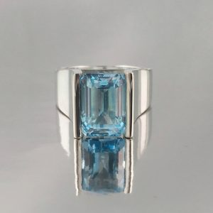 emerald cut topaz channel set in cocktail ring with wide band
