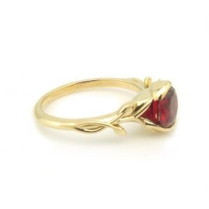 yellow gold vine ring featuring lab grown ruby
