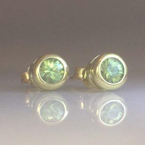 round green dementoid garnet stud earrings bezel set in 14k green gold