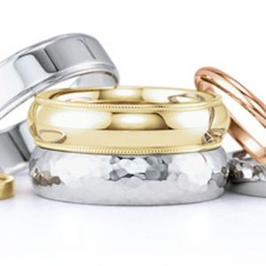 selection of different wedding bands in different colours of gold