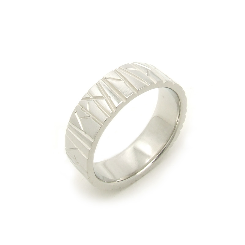 Wide, white gold wedding band with a carved branch motif that covers the whole top surface.
